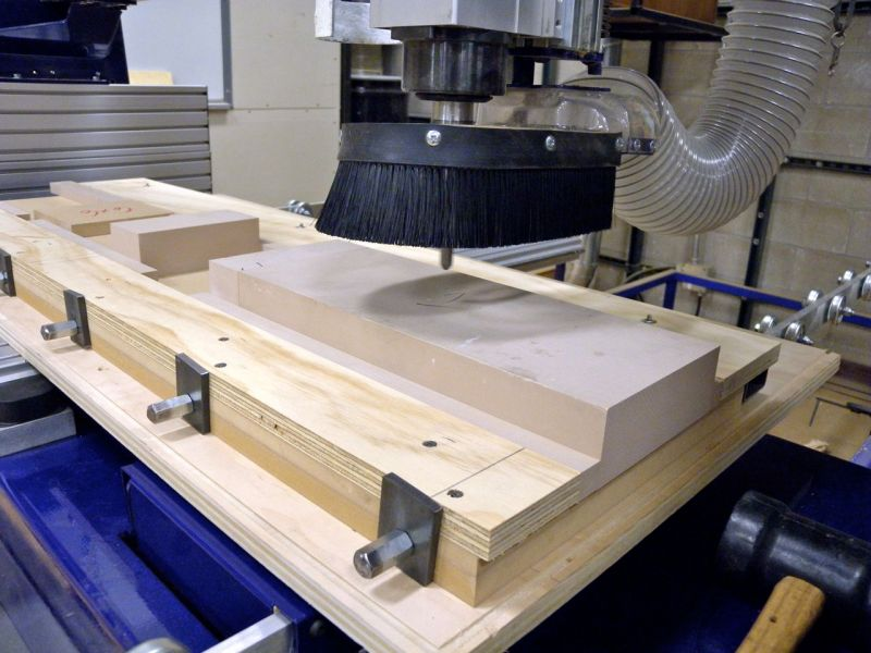 "The 6"" wide blanks of 2"" thick Renshape are clamped into the custom-made vice ready for the first layer of milling on the Shop Bot Buddy CNC router."