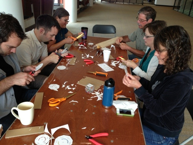 My colleagues at Texas Performing Arts cutting out gears to make their Mood-O-Meters. They may have lacked the exuberance of my elementary aged students but when they meshed their gears for the first time they were positively giddy.